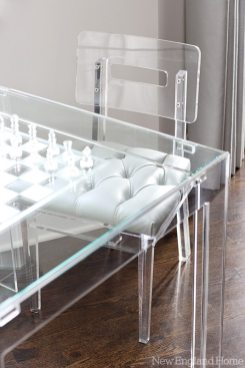 An etched-glass chessboard invites more family game time.