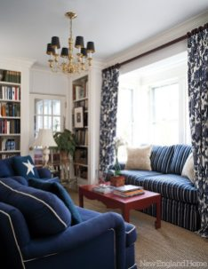 A cozy library off the kitchen sports club chairs covered in Lee Jofa fabric and a coffee table from Bungalow 5.