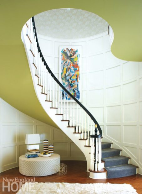 Designer Peter Sinnott brought interest to the space by adding soft green paint to the stairs' underside.