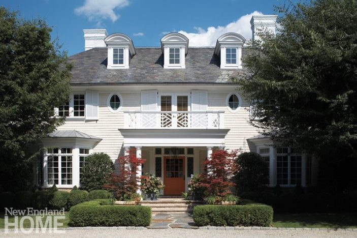 The portico was given a new set of more slender columns and a lighter, Chippendale-inspired railing. Upper windows were elongated, and new shutters added.