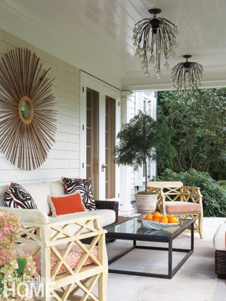 Custom-made ceiling fixtures add a dramatic touch to an outdoor sitting area.