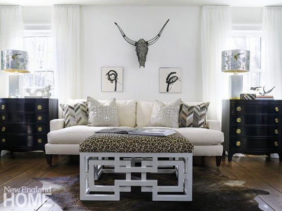 Diverse elements unite happily in the living room, where striking charcoal-on-paper drawings set off a steer's head cunningly crafted of metal washers. The herringbone-patterned hide sofa pillows hail from Dovecote in Westport.