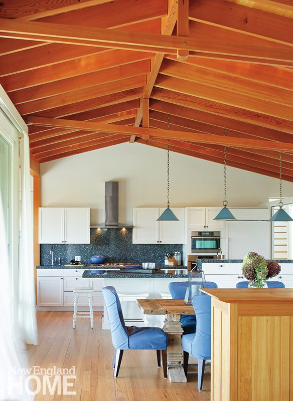 In the thoughtfully conceived kitchen, the backsplash and counters conjure the blues and grays of New England waterways as well as the stone that is so prominent outside.