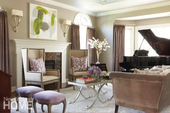 Designer and homeowner Susan Glick replaced the cozy dark tones of her living room with dusty grays and amethysts. A sofa that once wore olive-colored fabric was reupholstered in gray velvet and paired with new custom-made wing chairs.