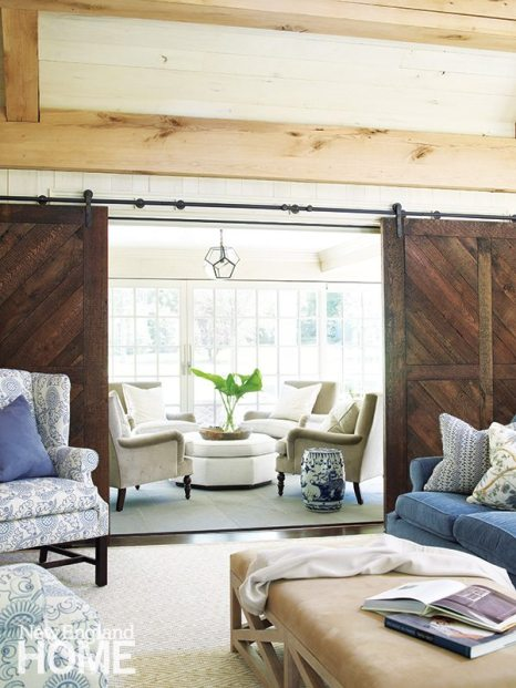 The sunroom's custom chairs and ottoman wear sturdy, but pretty, fabric by Perennials.