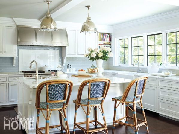 Polished metal light fixtures from Urban Archaeology illuminate the kitchen island.