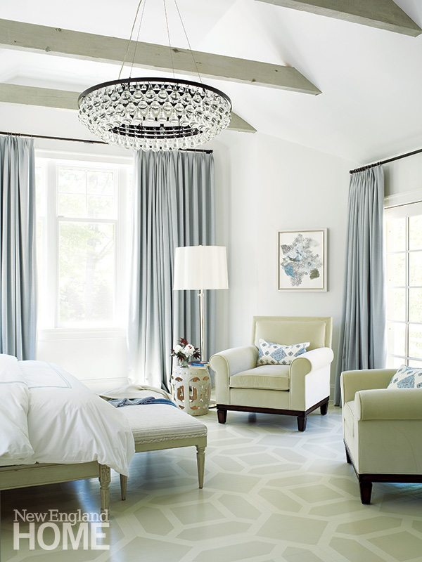A custom bench from Chelsea Editions cozies up to the master bed. For the drapes, Hirsch chose a wool flannel in keeping with the soothing palette. The wife isn't fond of carpeting, so Hirsch added a sense of texture by hand-stenciling the floor.