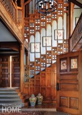 The foyer's original woodwork soars to the third floor.