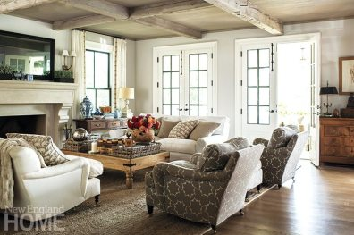 The kitchen opens to a family room that has a paneled ceiling and beams of reclaimed lumber.