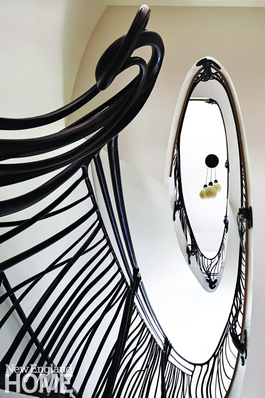 Architect Jeff Kaufman forged space for a floating staircase that winds its way to the top floor. Its dramatic ascent is accentuated with custom-designed railings by Dave Hind of Hamilton, Ontario.