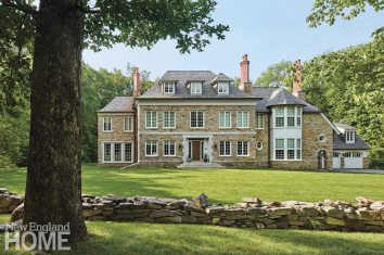 A granite exterior with custom limestone detailing gives the house presence