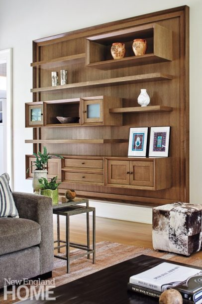 """Nesting tables and versatile animal-hide cubes ensure family-room functionality. Designer Dale Blumberg framed the bookcase """"to make it more like a piece of art,"""" she explains."""