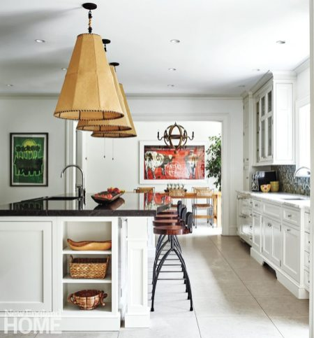 The sunny kitchen serves up a bounty of storage, with upper and lower cabinets and niches in the island. For snacks, the kids belly up to the island; casual meals take place in a breakfast area just off the kitchen.