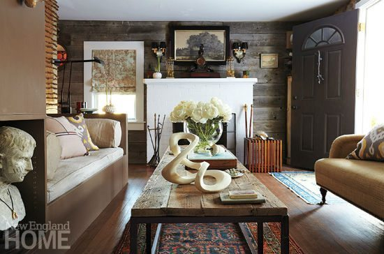 Reclaimed wood on one wall, silk grasscloth on another, the furnishings a joyful mix of old and older. This is Jonathan Bee's living room, where the homeowner's love of eclecticism welcomes visitors like that first breath of fresh spring air.