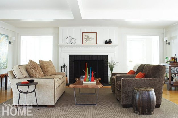 """The living room's large fireplace threatened to overpower the living room, so Kalur used her signature """"chic neutrals"""" to scale back its imposing size."""
