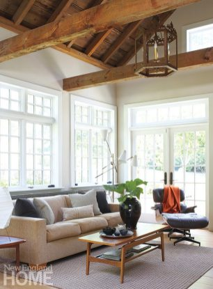 Walls of windows in the family room provide generous outside views.