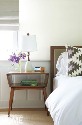 A midcentury bedside table suits the master bedroom.