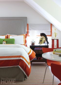 In the son's bedroom, Pottery Barn sheets are a vibrant contrast to the gray headboard and shades in linen from Kravet.
