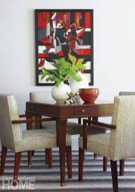 An Irene Zevon painting adds a bright note to the game corner.