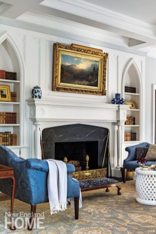 The architects designed the living room's Gothic-style bookcases and the mantel with its inset quatrefoils.