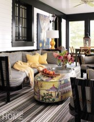 Checks, stripes, and a laminated fabric in a romantic print by Manuel Canovas mix happily on the sophisticated porch.