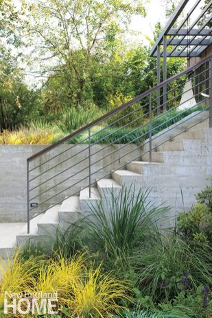 Landscape architect Matthew Cunningham planted masses of grasses and sedges both at the base of the wall and on the upper level to soften the geometry of the contemporary architecture.