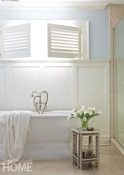 A simple wainscot panel in the master bath keeps with the simplicity of the house.