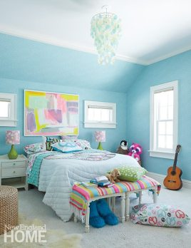 A painting by Kerri Rosenthal sets off the daughter's already-colorful space.