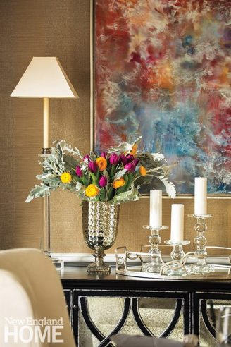 A bright piece by Darien artist Andrea Bonfils adds color to the dining room.