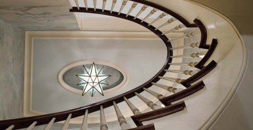 A whimsical star illuminates the grand staircase.