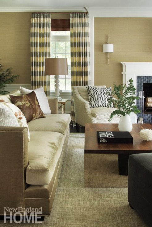The shimmer of silk and velvet adds a posh factor to the living room's serene sitting area.