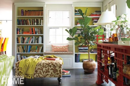 Salk painted the backs of the built-in shelves chartreuse to give them definition and make the books pop. The window seat is upholstered in fabric from Ballard Designs.