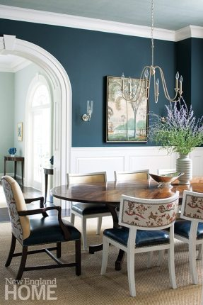 Blues of every hue prevail throughout the classic home. Though formal, the dining room and living room (facing page), are not off-limits to the homeowners' three small children, thanks to sisal rugs, durable casegoods, and forgiving fabrics; a mix of three-including faux leather-adorn the dining chairs.