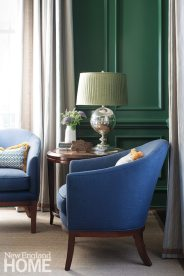 The dark cherry library was made more feminine with a jolt from green-lacquered walls and rich velvet accent chairs.