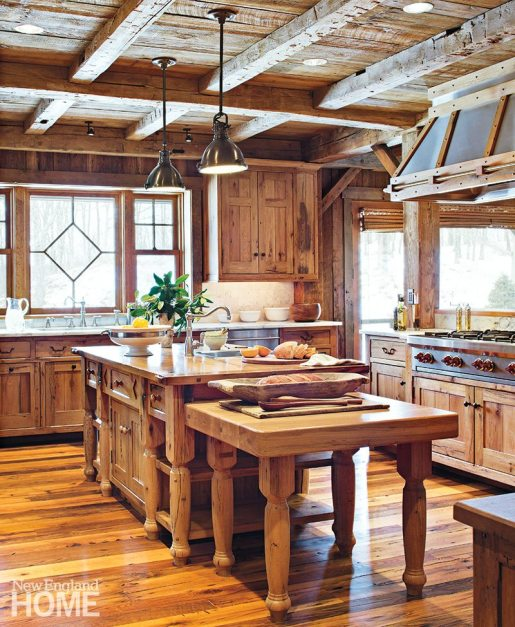 The house's rich oak flooring is most evident in the open kitchen.