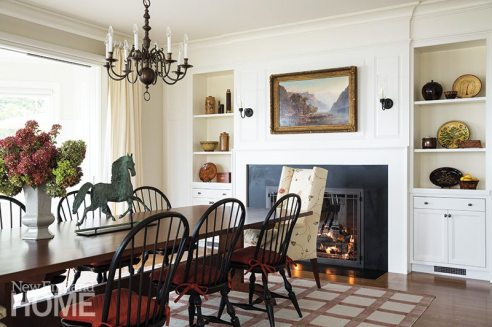 A Blanche Field chandelier and classic Windsor chairs sound traditional notes in the dining room.