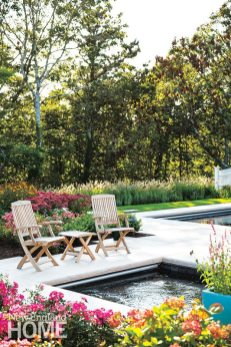 Poolside plantings skillfully dovetail with the natural landscape beyond.