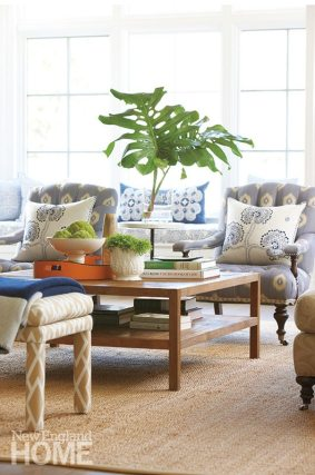 The wife's favorite shade of blue and a soft-underfoot jute rug bring a casual vibe to the family room.