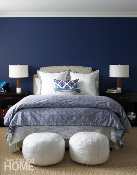 "Dark-blue walls and a mix of textiles create an upscale ""man cave"" for the son."