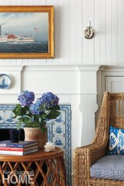 The blue-and-white fireplace tile and the woodwork details from a previous renovation were preserved.