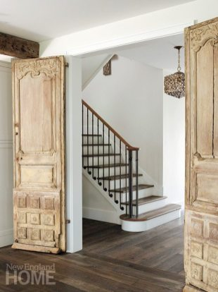 The generous opening to the family room was designed to complement the grand old doors.