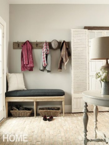 Reclaimed Chicago brick, sealed for easy cleaning, makes the mudroom child-friendly.