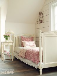 A scalloped bed skirt from Blanc D'Ivoire and a Restoration Hardware coverlet are feminine touches in daughter Ciara's room.