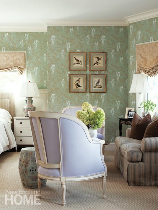 The refined country motif of the master bedroom includes a Cole & Son wallpaper, linen damask shades, and heirloom-quality furniture.