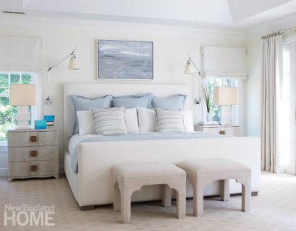 A palette of cool blues creates a soothing atmosphere in the master bedroom.