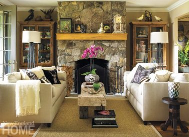 Local stone also sheaths the fireplace in the living room, where linen-clad sofas sit among a trove of antiques.