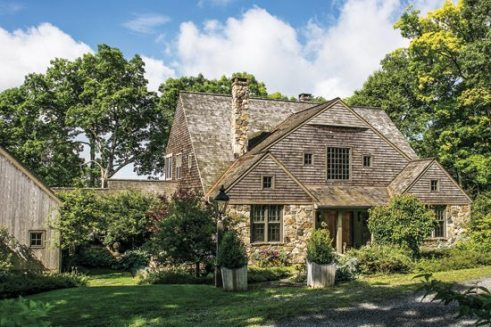 The native stone facade links the house to its setting, while the inset entry offers both shelter and a bit of drama.