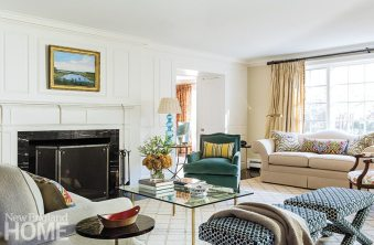 Silk and velvet fabrics give the living room a luxurious formality.