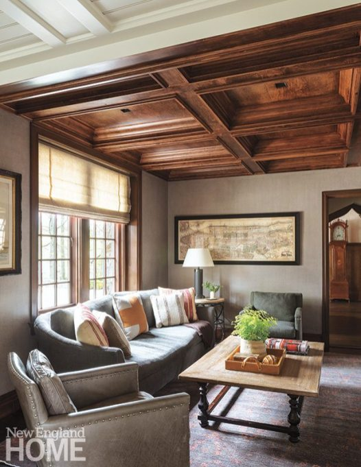 """We picked the antique rug before we even knew what we were going to do with the family room,"" says Westcott. An antique map and leather chair also boost the room's cozy spirit."