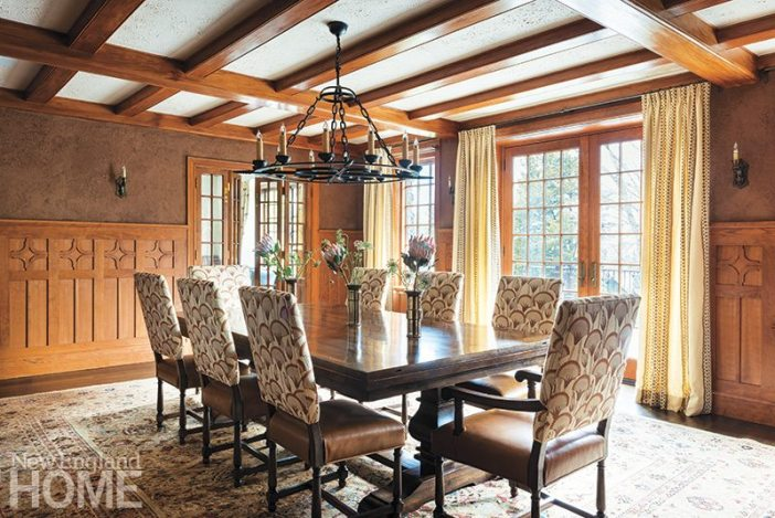 The owner designed the dining room's chair rail, and builder Artur Domka meticulously crafted it. The fabric on the upholstered chairs and at the windows is by Katie Leede. French doors leading into the living room are a new addition.